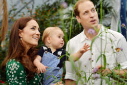 This July 2, 2014, file photo shows Britain's Prince William and Kate Duchess of Cambridge and Prince George during a visit to the Sensational Butterflies exhibition at the Natural History Museum, London.  (AP Photo/John Stillwell, File)