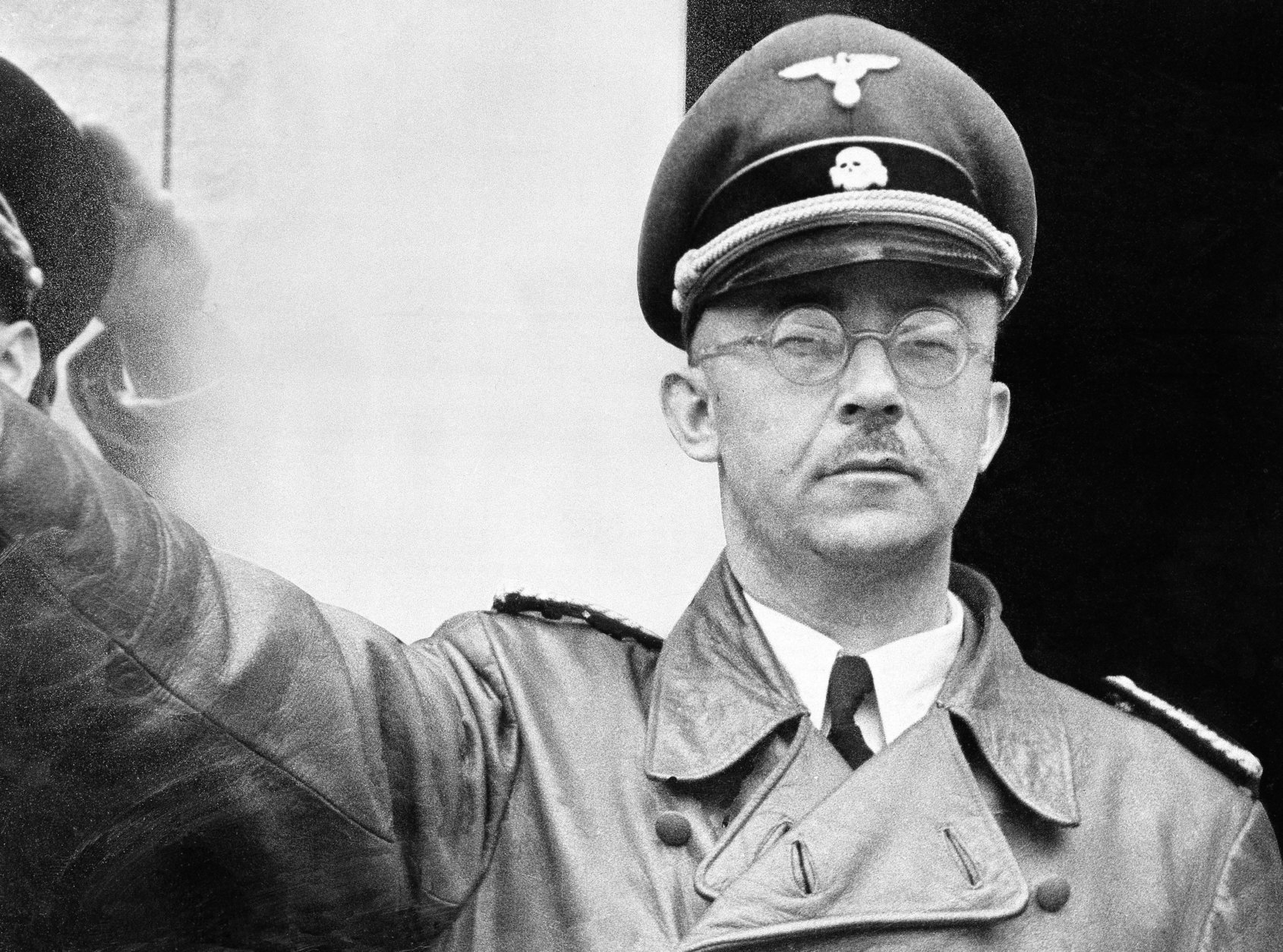 """FILE - The undated file photo shows German Nazi party official and head of the SS, Heinrich Himmler. at unknown location in Germany. German newspaper Welt am Sonntag has published a trove of letters believed to be written by Nazi SS leader Heinrich Himmler. On seven full pages the paper on Sunday Jan. 26,2014  showed pictures of Himmler and his family smiling into the camera during a fishing trip, the top Nazi taking a bath in a lake or feeding a little fawn. The newspaper, which says the material is contained in an eight-part series it plans to publish, also quotes excerpts from Himmler's love letters addressing his wife as """"my sweet, beloved little woman."""" Welt said it worked together with Israeli film director Vanessa Lapa, whose family had the documents in its possession.  (AP Photo/str/file)"""