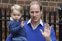 FILE - In this Saturday, May 2, 2015 file photo, Britain's Prince William and his son Prince George wave as they return to St. Mary's Hospital's exclusive Lindo Wing, London. William's wife, Kate, the Duchess of Cambridge, gave birth to a baby girl on Saturday morning.  Britain's royals on Wednesday July 22 ,2015 celebrate the second birthday of George, the first child of Prince William and his wife, Kate.   (AP Photo/Kirsty Wigglesworth, file)