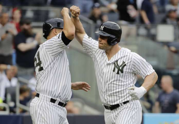 Holliday's homer lifts Yankees over A's