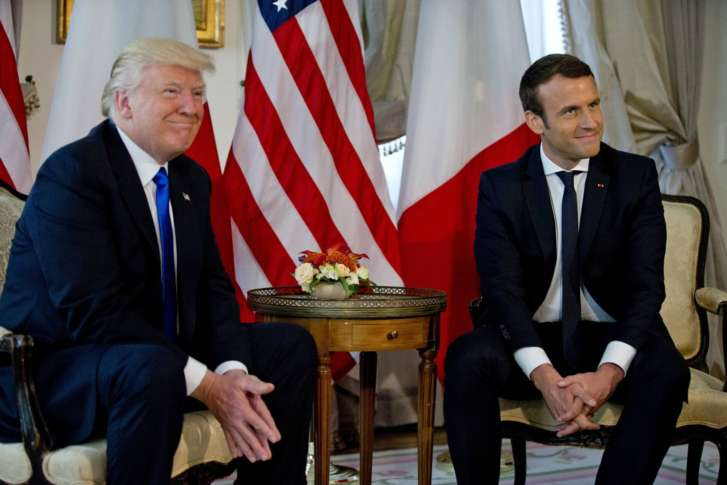 France President, Macron swerves past Trump to embrace Merkel