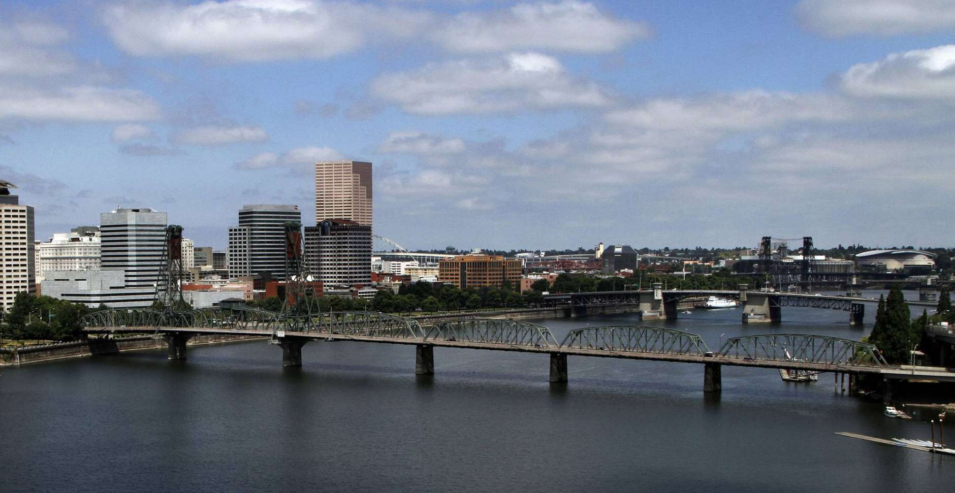 FILE - In this Aug. 1, 2012 file photo, the downtown skyline is shown on the west bank of the Willamette River in Portland, Ore. As Oregon endures an acute housing shortage, the Legislature is considering making landlords pay tenants for no-cause evictions. The bill would also reverse a law that bans most rent controls, allowing cities and counties to adopt their own rent-controls.  (AP Photo/Don Ryan, File)