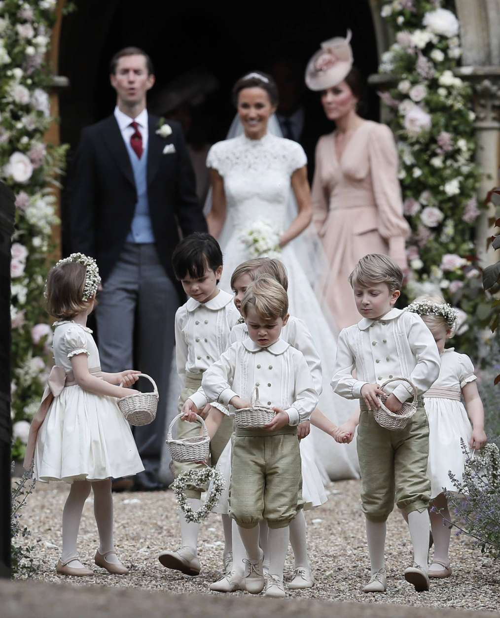 Prince George, center, stands with other flower boys and girls after the wedding of Pippa Middleton and James Matthews at St Mark's Church in Englefield, England Saturday, May 20, 2017. Middleton, the sister of Kate, Duchess of Cambridge married hedge fund manager James Matthews in a ceremony Saturday where her niece and nephew Prince George and Princess Charlotte was in the wedding party, along with sister Kate and princes Harry and William. (AP Photo/Kirsty Wigglesworth, Pool)