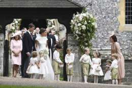 Britain's Kate, the Duchess of Cambridge, right, stands with her children Prince George and Princess Charlotte, following the wedding ceremony of her sister Pippa Middleton and James Matthews, at St Mark's Church in Englefield, England Saturday, May 20, 2017. Middleton, the sister of Kate, Duchess of Cambridge married hedge fund manager James Matthews in a ceremony Saturday where her niece and nephew Prince George and Princess Charlotte was in the wedding party, along with sister Kate and princes Harry and William. (Justin Tallis/Pool Photo via AP)