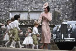 Kate, the Duchess of Cambridge, right, leads the bridesmaids and pageboys, including her son Prince George, centre and daughter Princess Charlotte, after the wedding of her sister Pippa Middleton to James Matthews, at St Mark's Church in Englefield, England Saturday, May 20, 2017. Middleton, the sister of Kate, Duchess of Cambridge married hedge fund manager James Matthews in a ceremony Saturday where her niece and nephew Prince George and Princess Charlotte was in the wedding party, along with sister Kate and princes Harry and William. (Justin Tallis/Pool Photo via AP)