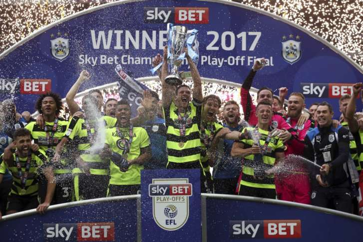 Huddersfield's players and manager celebrated their play-off victory at one man's expense