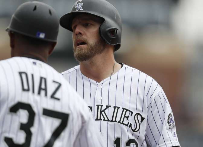 Reynolds, Rockies rough up Cubs 10-4 in opener of DH