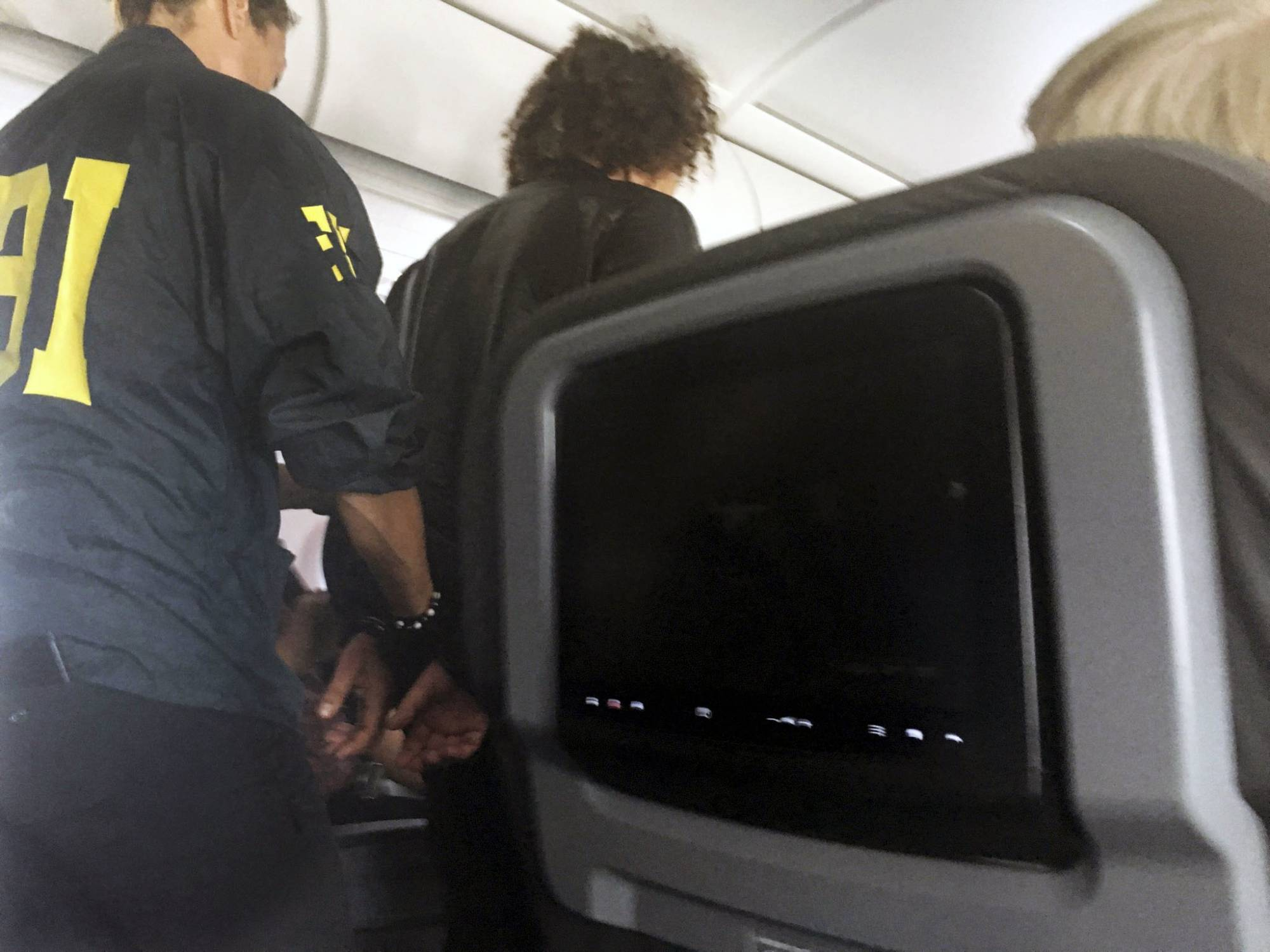Unruly, 'disheveled' man duct taped to seat on jet heading to Hawaii
