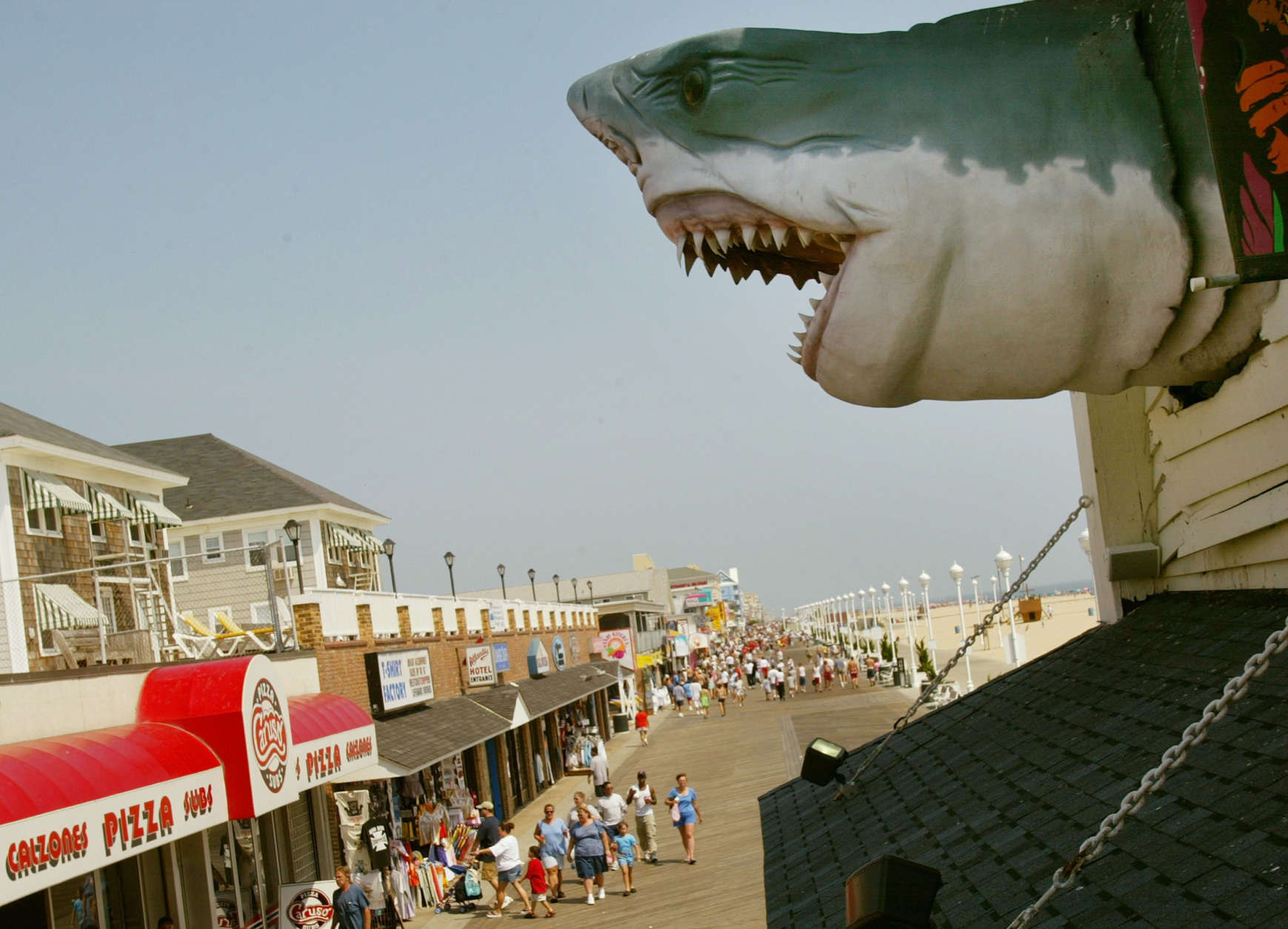 Ocean City is most associated with its wooden boardwalk, which is lined with shops, restaurants, hotels and a small amusement park. A handful of the boardwalk-based businesses have been operating for 100-plus years. (Photo by Mark Wilson/Getty Images)