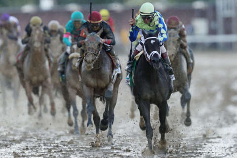 The Latest: Always Dreaming wins Kentucky Derby in slop
