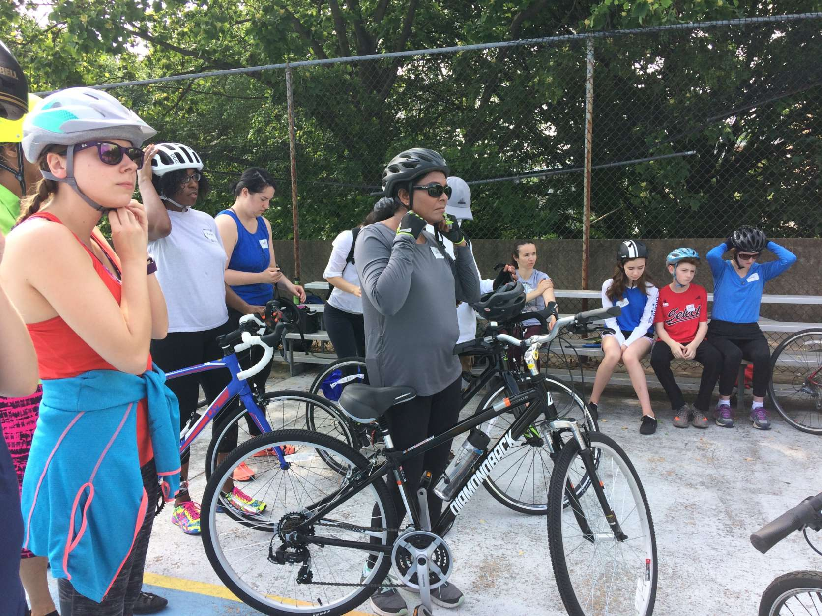 Riders during a Washington Area Bicyclist Association City Cycling class in Arlington, Virginia, on April 30, 2017, listen to announcements before the start of class. (WTOP/Abigail Constantino)