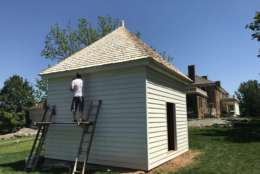 """On June 5, James Madison's Montpelier will open its new exhibit, """"The Mere Distinction of Colour,"""" a project that's been two years in the making. The exhibition includes recreated slave quarters in the side yard, as well as interactive displays and videos in the mansion's cellar. (WTOP/Rachel Nania)"""