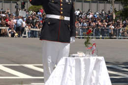 A saluting member of theMarine Corps honors a fallen comrade at the 25th annual demonstration Rolling Thunder demonstration in D.C. The group remains resolved to help bring home prisoners of war and those missing in action. (Courtesy Rolling Thunder)