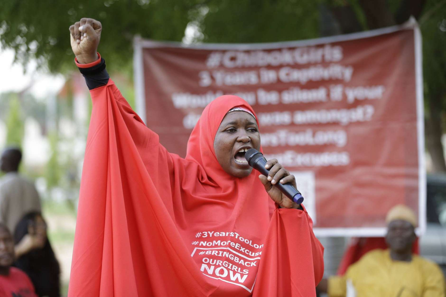 Aisha Yusuf, a 'Bring Back Our Girls' campaigner, speaks on the release of the kidnapped Chibok School Girls at the unity fountain in Abuja, Nigeria, Sunday, May 7, 2017. Five Boko Haram commanders were released in exchange for the freedom of 82 Chibok schoolgirls kidnapped by the extremist group three years ago, a Nigerian government official said Sunday, as the girls were expected to meet with the country's president and their families. (AP Photo/ Sunday Alamba)