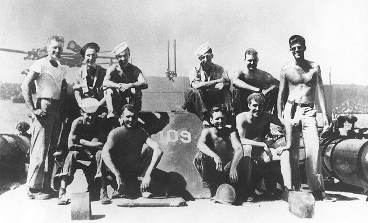 Future president John F. Kennedy, at right, with his PT-109 crew. (Collections of the U.S. National Archives, downloaded from the Naval Historical Center)