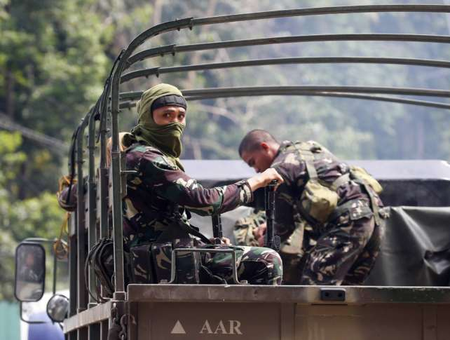 Philippine President Duterte tells troops 'you can arrest any person'