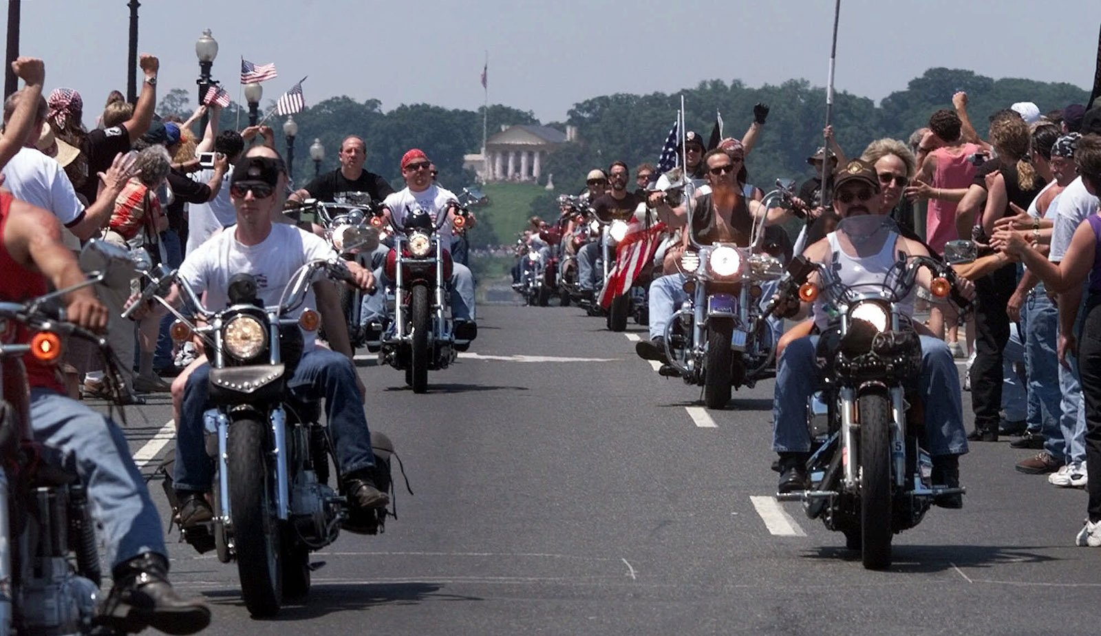 "Some of an estimated 250,000 bikers descend upon Washington to take part in the 12th Annual ""Rolling Thunder"" memorial honoring POW's and MIA's Sunday, May 30, 1999.  In the background is Arlington National Cemetery. (AP Photo/Khue Bui)"