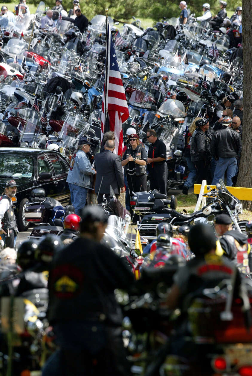 "Hundreds of motorcycles arrive at Arlington National Cemetery as part of a ""Rolling Thunder"" ceremony for Vietnam Veterans on Saturday, May 29, 2004 in Arlington, Va.  The groups leaders will meet with President Bush on Sunday.  (AP Photo/Evan Vucci)"