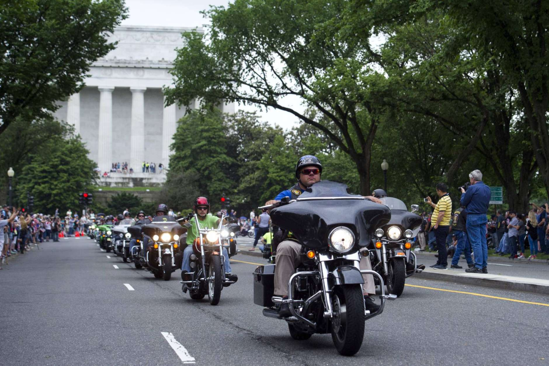 Motorcyclists pass the Lincoln Memorial during the 30th anniversary of the Rolling Thunder 'Ride for Freedom' in Washington, Sunday, May 28, 2017. Rolling Thunder seeks to bring full accountability for all U.S. prisoners of war and missing in action (POW/MIA) soldiers. (AP Photo/Cliff Owen)
