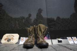 A pair of military boots are left at the Vietnam Veterans Memorial during the 30th anniversary of the Rolling Thunder 'Ride for Freedom' demonstration in Washington, Sunday, May 28, 2017. Rolling Thunder seeks to bring full accountability for all U.S. prisoners of war and missing in action (POW/MIA) soldiers. (AP Photo/Cliff Owen)