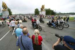 Motorcyclists cross the Memorial Bridge during the 30th anniversary of the Rolling Thunder 'Ride for Freedom' demonstration in Washington, Sunday, May 28, 2017. Rolling Thunder seeks to bring full accountability for all U.S. prisoners of war and missing in action (POW/MIA) soldiers. (AP Photo/Cliff Owen)