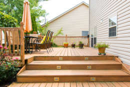 Carpenter bees attacking your wooden deck or porch? Mike McGrath suggests homeowners try building the bees an alternative habitat, almond oil can also help. But applying a paint or wood stain will be the only long-term solution to stop those pollinators in their tracks. (Thinkstock)