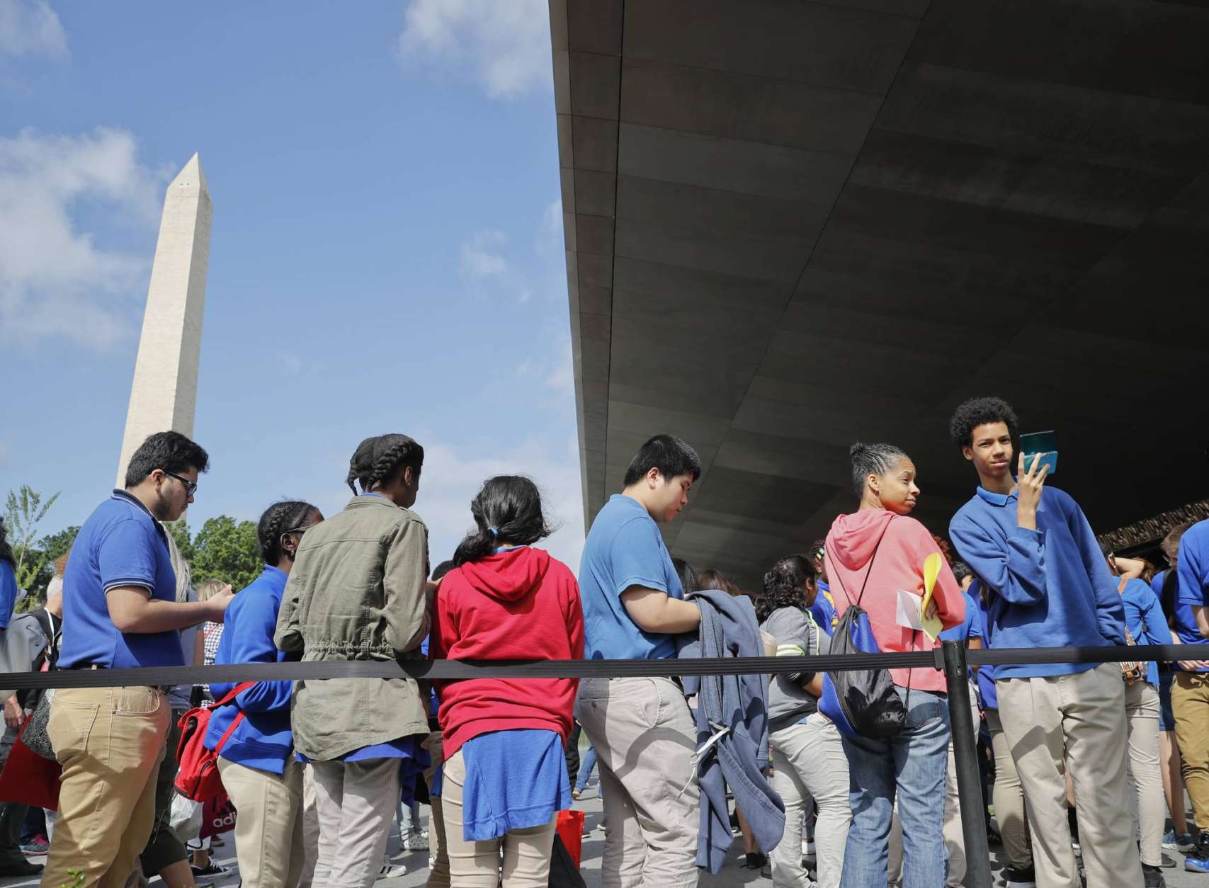 A school group waits in line to enter Smithsonian National Museum of African American History and Cultural on the National Mall in Washington, Monday, May 1, 2017. The hottest ticket in Washington right now is for the new museum, where thousands of tickets are snapped up each month within minutes of being released, a full seven months after the museum opened. (AP Photo/Pablo Martinez Monsivais)