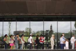 Visitors have their ticket scanned as they wait in line outside the Smithsonian National Museum of African American History and Cultural on the National Mall in Washington, Monday, May 1, 2017. The hottest ticket in Washington right now is for the new museum, where thousands of tickets are snapped up each month within minutes of being released, a full seven months after the museum opened. (AP Photo/Pablo Martinez Monsivais)