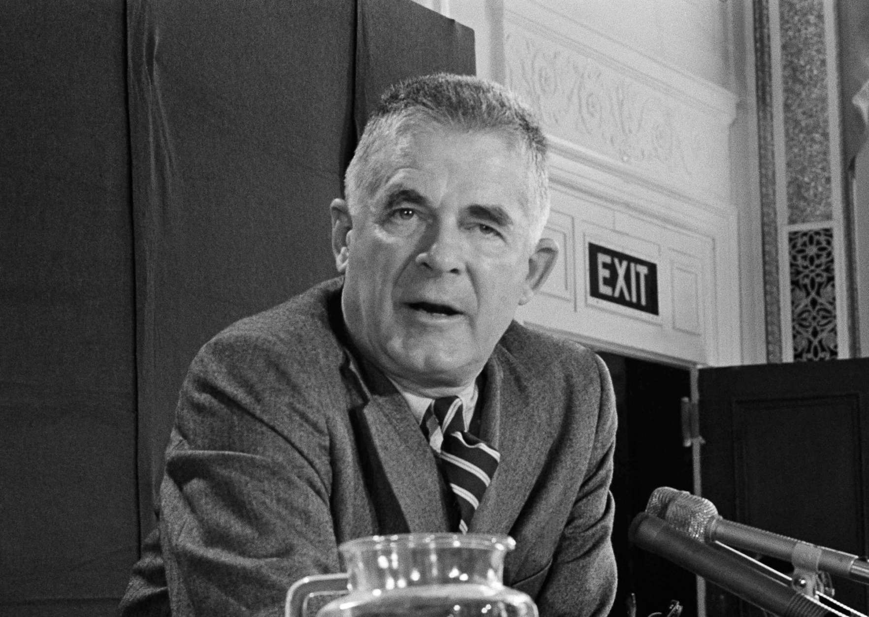 """FILE - In this Oct. 20, 1973 file photo, Archibald Cox speaks at a news conference in Washington. Comparisons to the Nixon-era """"Saturday night massacre"""" were swift after President Donald Trump fired the acting attorney general for refusing to enforce his executive order on immigrants and refugees. In both cases, a dispute between a president and his Justice Department led to an evening maneuver by the president to install an acting attorney general more to his liking. (AP Photo/John Duricka, File)"""