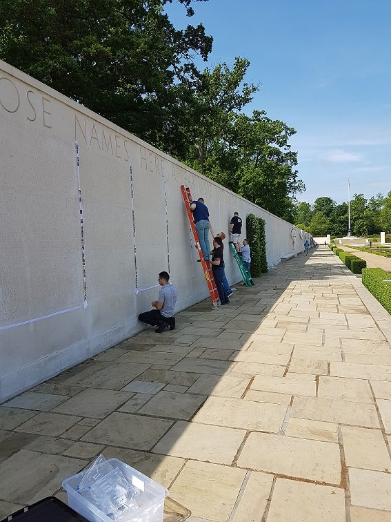 Photos of fallen American service members have been placed next to headstones and names on the Walls of the Missing at Cambridge American Cemetery as part of the Faces of Cambridge. (Courtesy American Battle Monuments Commission)