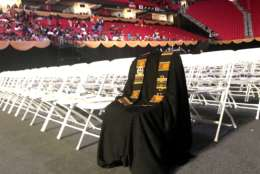 The image of murdered Lt. Richard Collins III's gown at the Bowie State University graduation has prompted a wide variety of emotions. (WTOP/Neal Augenstein)