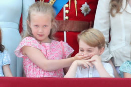 Savannah Phillips and Prince George of Cambridge watch the flypast on the balcony of Buckingham Palace during Trooping The Colour on June 9, 2018 in London, England.