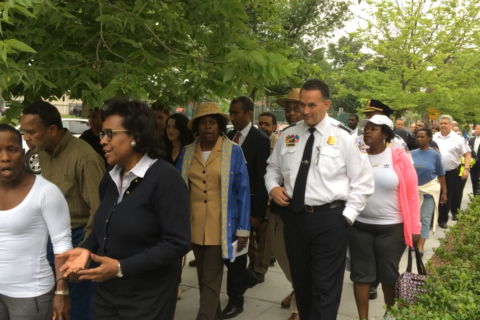 After fatal gunfire unsettles NW DC neighborhood, residents walk together