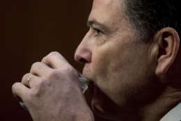 Former FBI director James Comey takes a drink of water as he testifies at a Senate Intelligence Committee hearing on Capitol Hill, Thursday, June 8, 2017, in Washington. (AP Photo/Andrew Harnik)