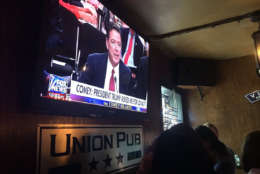 Former FBI Director James Comey on the big screen at Union Pub on Capitol Hill. (WTOP/Anna Isaacs)
