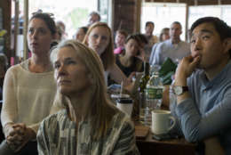 People watch as former FBI director James Comey testifies during a Senate Intelligence Committee hearing, Thursday, June 8, 2017, at the Building on Bond in the Brooklyn borough of New York. (AP Photo/Mary Altaffer)