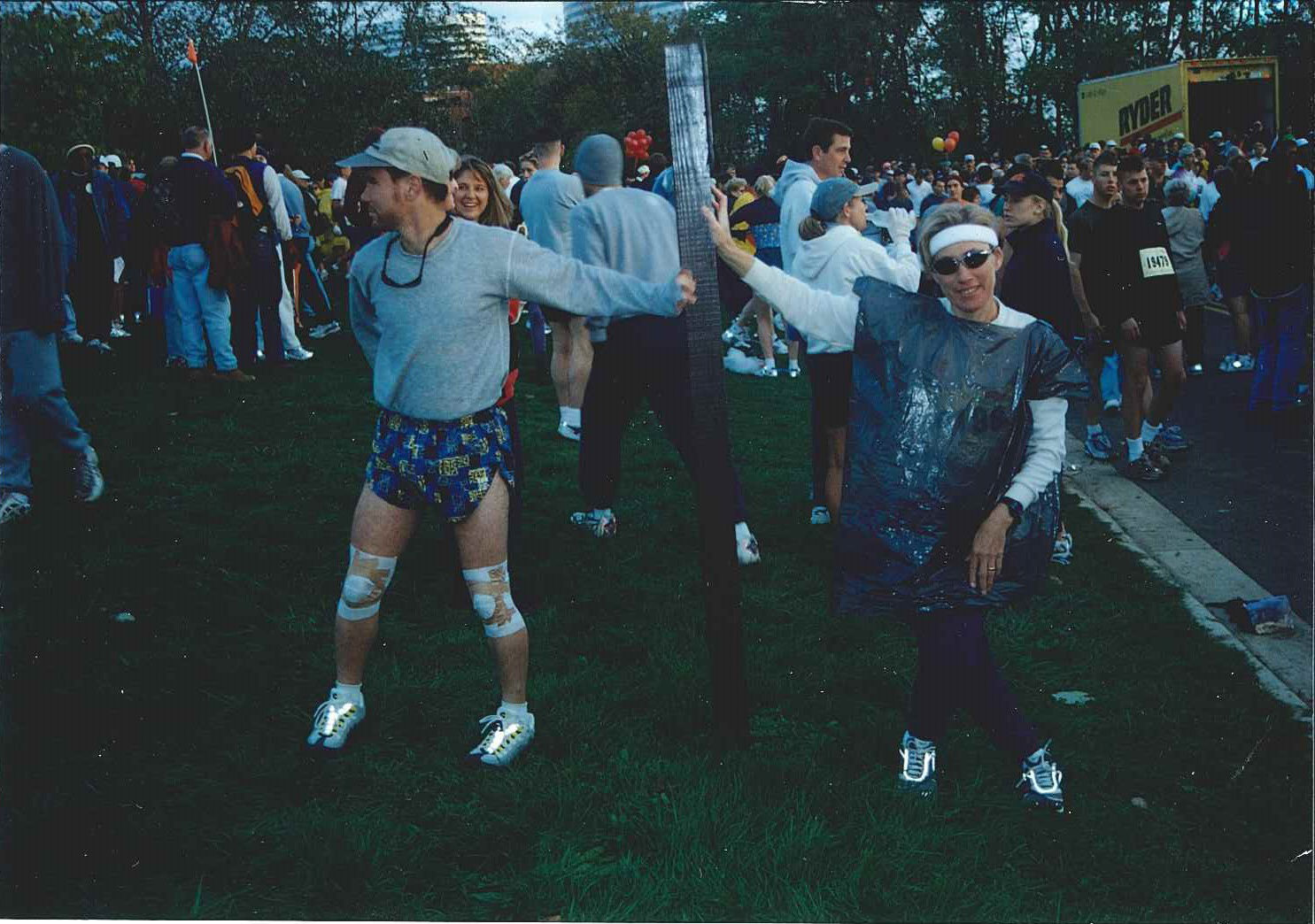 Runners stretching at the start of the race. Year not known. (Courtesy Marine Corps Marathon)