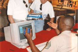 A Marine at a computer during the 1993 Marine Corps Marathon expo. (Courtesy Marine Corps Marathon)