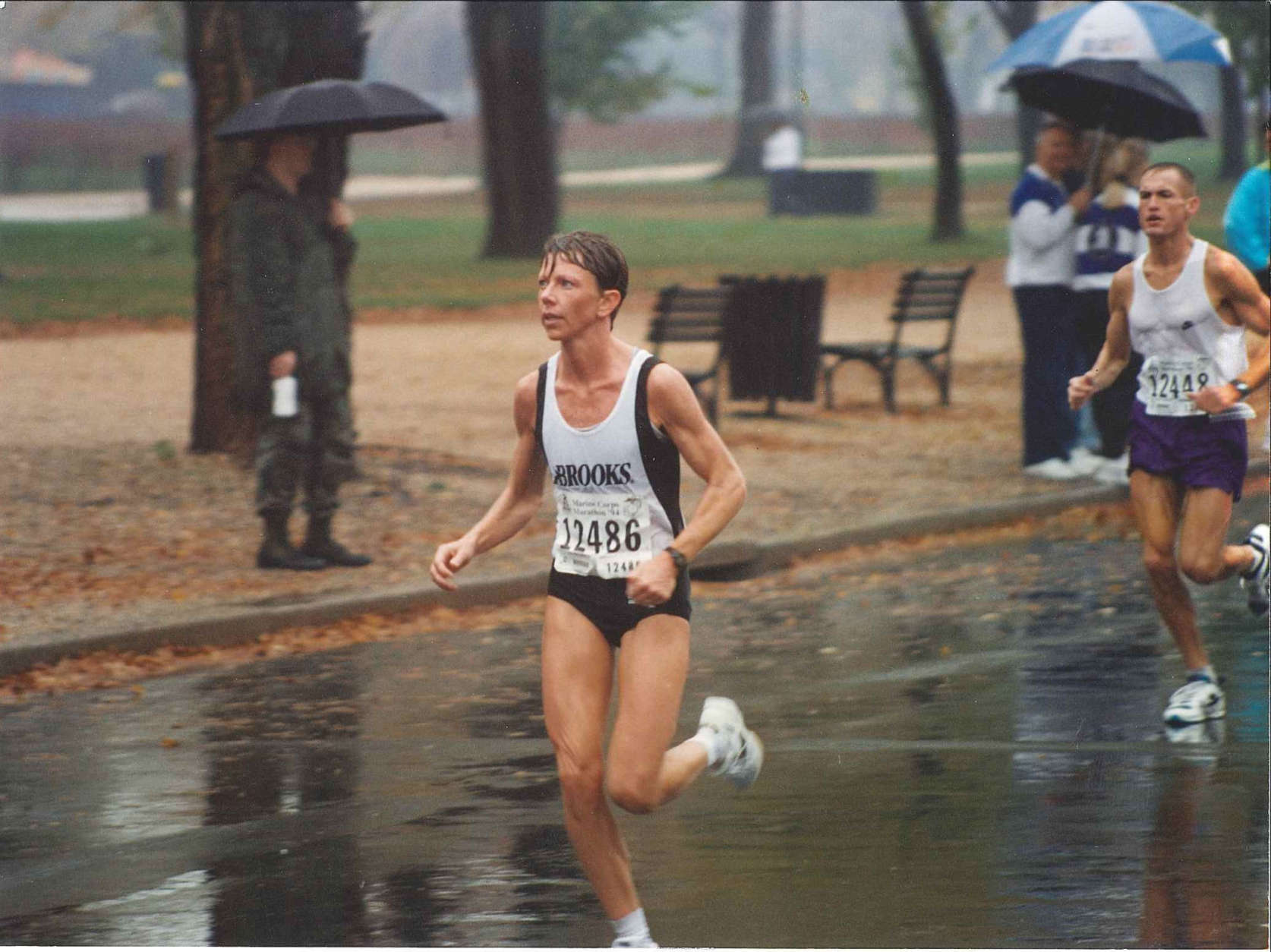 Donna Moore runs in the rain in 1997. The Kensington, Maryland, woman went on to win the race that year. (Courtesy Marine Corps Marathon)