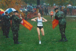 Donna Moore crosses the finish line of the 1997 Marine Corps Marathon as the first place female finisher. (Courtesy Marine Corps Marathon)