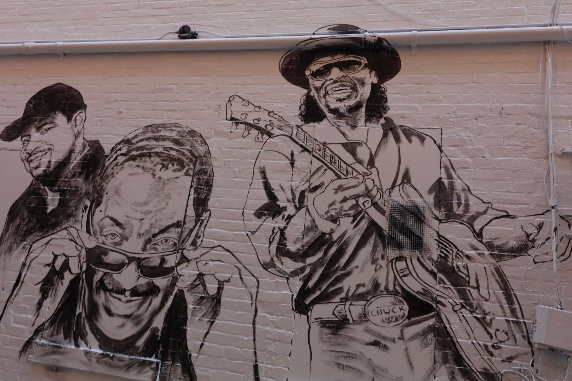 From left: Russ Parr, Donnie Simpson and Chuck Brown are among the new faces on the Ben's Chili Bowl mural (WTOP/Kate Ryan)