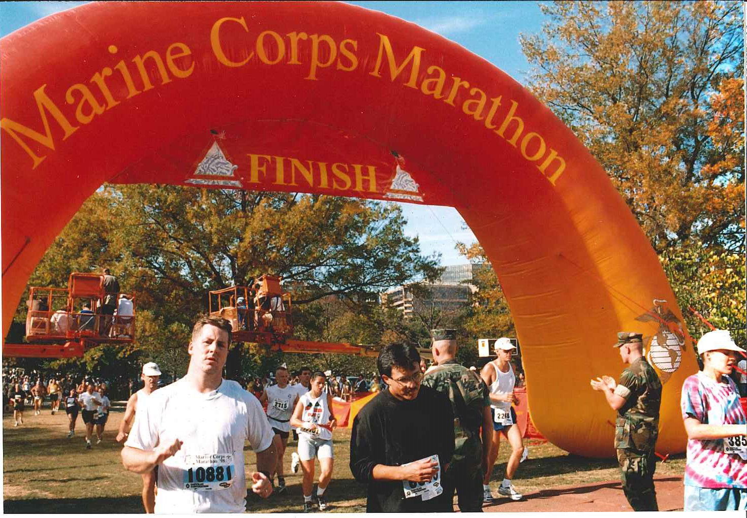 Runners cross the finish line during the 1998 race. (Courtesy Marine Corps Marathon)
