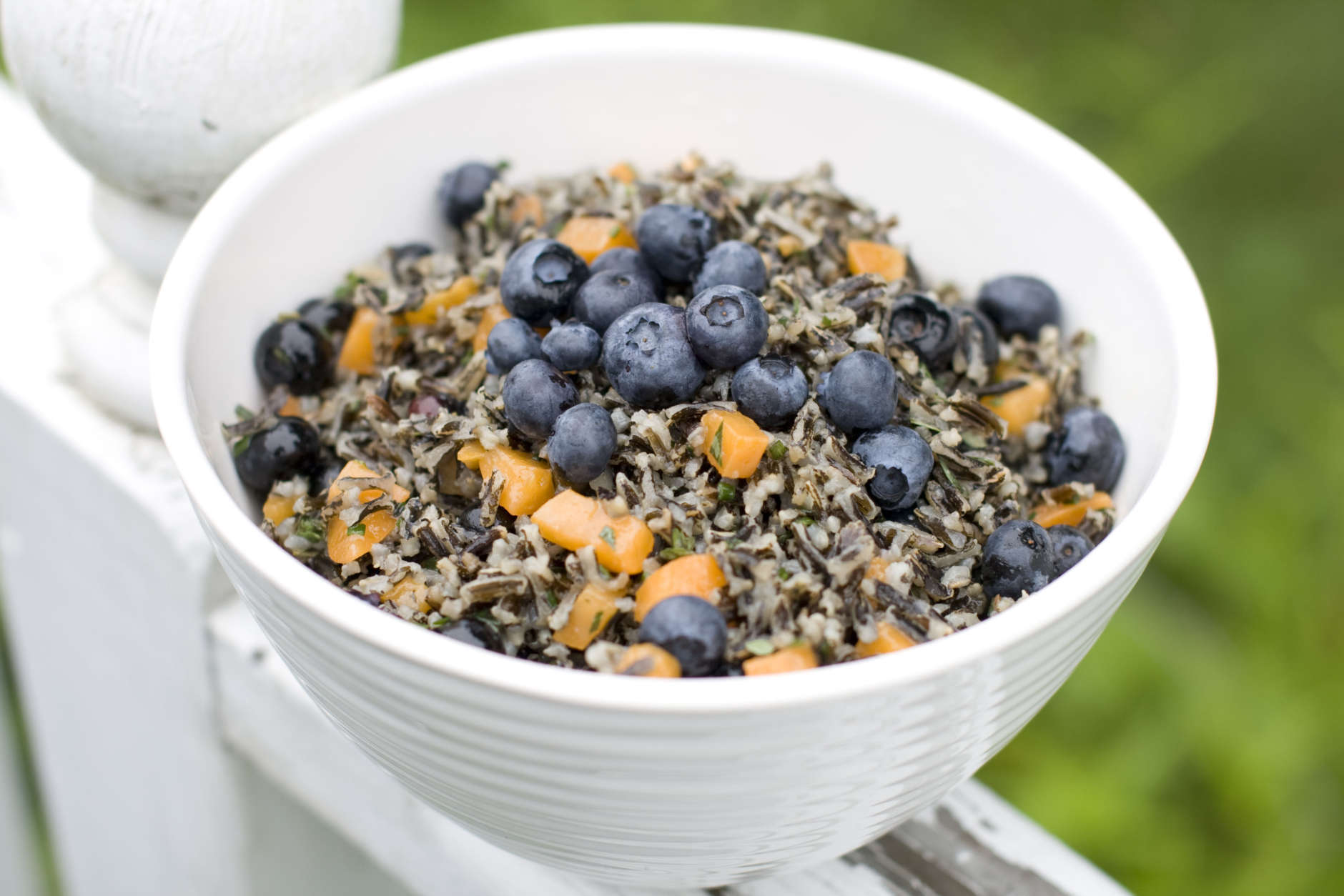 This July 22, 2013 photo shows a recipe for herbed wild rice salad with apricots and blueberries. (AP Photo/Matthew Mead)