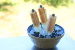 This Aug. 3, 2015 photo shows peach blueberry frozen pops in Concord, NH.This easy recipe for peach-blueberry frozen pops is a great way to use some of your frozen fruit stash any time of year. (AP Photo/Matthew Mead)