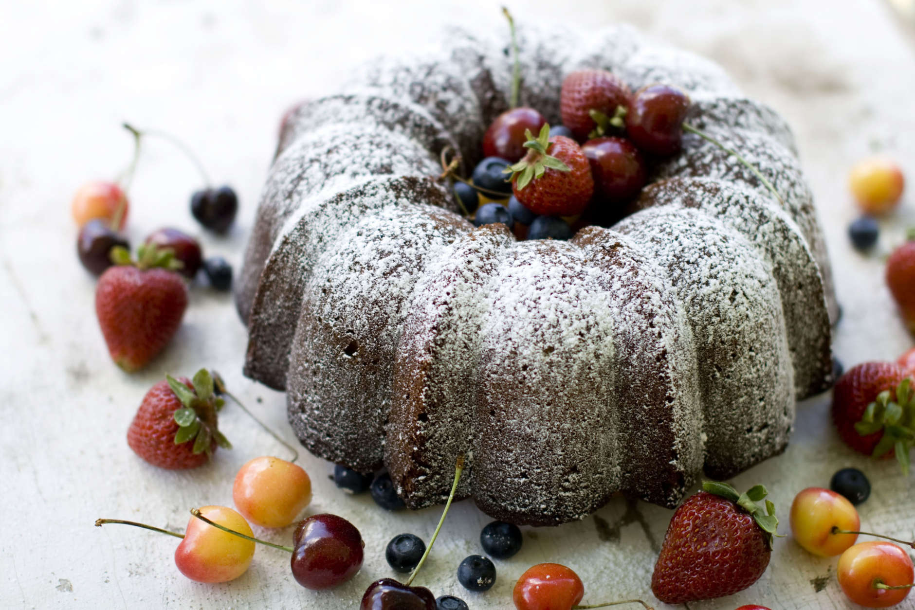 In this image taken on July 9, 2012, an economy pound cake served with blueberries, cherries, and strawberries is shown in Concord, N.H. (AP Photo/Matthew Mead)