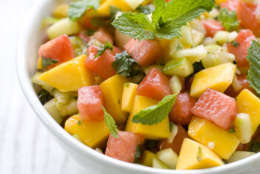 In this image taken on July 24, 2012, Arthur Potts Dawson's cucumber, watermelon and mango salad with spicy red and green chilies is shown served in a bowl in Concord, N. H. (AP Photo/Matthew Mead)