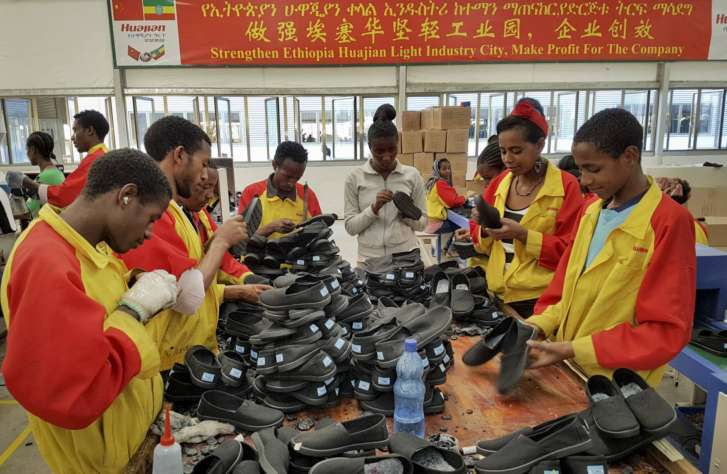 5, 2017, photo, Ethiopian factory workers sort shoes at the Chinese company  Huajian's plant in Addis Ababa, Ethiopia. Workers from at Ganzhou Huajian  ...