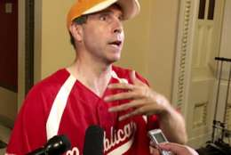 Rep. Chuck Fleischmann, R-Tenn., still wearing his baseball shirt, describes for reporters on Capitol Hill in Washington, Wednesday, June 14, 2017, the scene at a congressional baseball practice in Alexandria, Va., earlier where a gunman opened fire wounding House Majority Whip Steve Scalise, R-La. during a Congressional baseball practice. (AP Photo/Matthew Daly)
