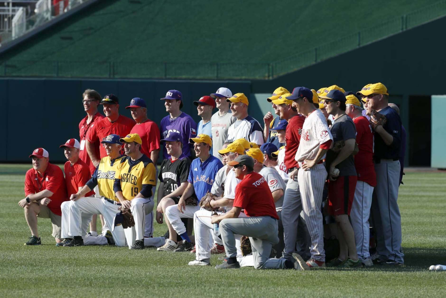 Wearing mostly Louisiana State University hats, the Republican team poses for a team picture before the Congressional baseball game, Thursday, June 15, 2017, in Washington. The annual GOP-Democrats baseball game raises money for charity. (AP Photo/Alex Brandon)