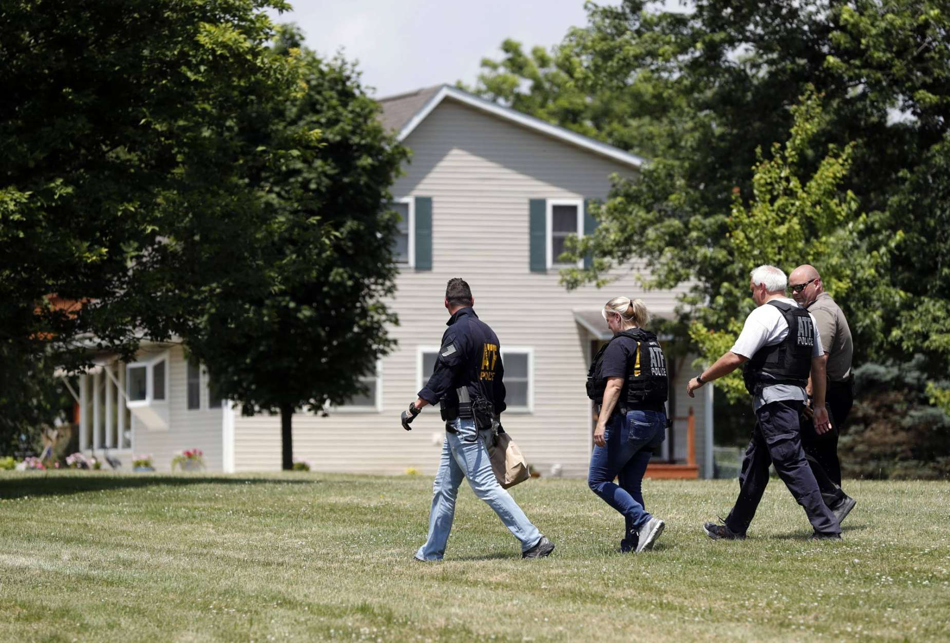 Law enforcement investigate outside the home of James T. Hodgkinson on Wednesday, June 14, 2017, in Belleville, Ill. Officials said Hodgkinson has been identified as the man who opened fire on Republican lawmakers at a congressional baseball practice Wednesday morning in Alexandria, Va. (AP Photo/Jeff Roberson)